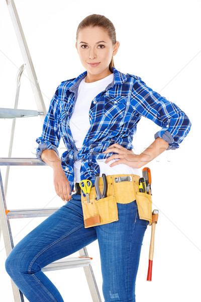 Pretty Young Carpenter Woman on Steel Ladder Stock photo © dash
