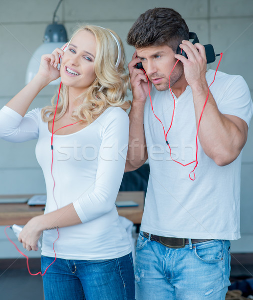 Young Couples on White Blue Attire Listening Music Stock photo © dash