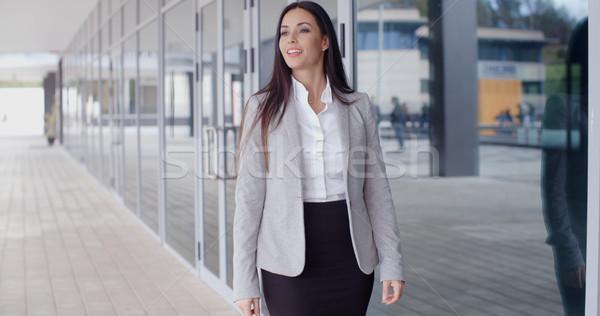 Gorgeous business woman walking Stock photo © dash