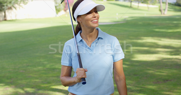 Young woman golfer strolling across the course Stock photo © dash