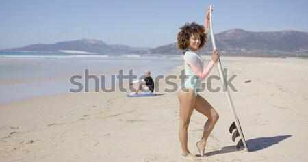 женщины доска для серфинга морем другой руки Сток-фото © dash