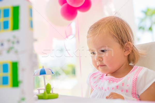 Sweet небольшой девушки наслаждаться рождения настоящее Сток-фото © dash