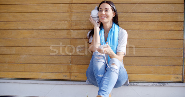 Happy relaxed young woman listening to music Stock photo © dash