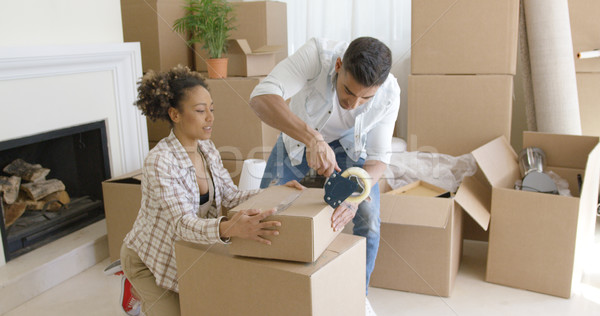 Young couple packing boxes to move home Stock photo © dash