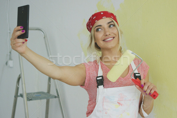 Cheerful female taking selfie with paint roller Stock photo © dash