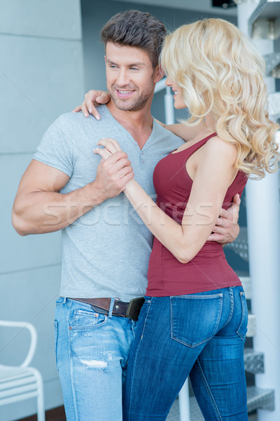 Happy Couple Dancing with Arms Around Each Other Stock photo © dash