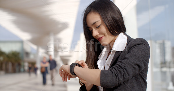 Attractive woman checking the time Stock photo © dash