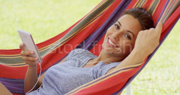 Boldog fiatal nő zenét hallgat függőágy kint napos Stock fotó © dash