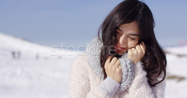 Young woman on ski slope with cozy sweater Stock photo © dash