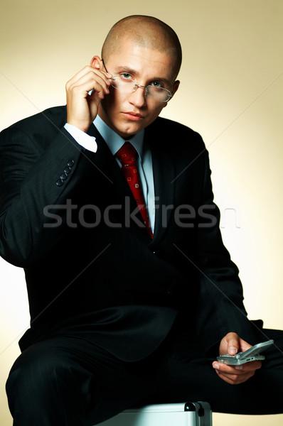 Stok fotoğraf: Işadamı · siyah · takım · elbise · cep · telefonu · oturma · durum
