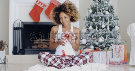 Sexy young woman relaxing on her bed at Christmas Stock photo © dash