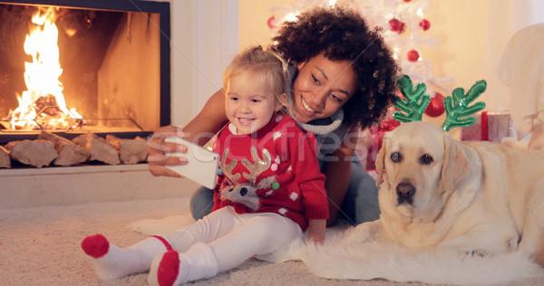 Happy family selfie portrait at Christmas Stock photo © dash