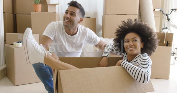 Mosolyog fiatal nő karton karton vigyorog csodál Stock fotó © dash