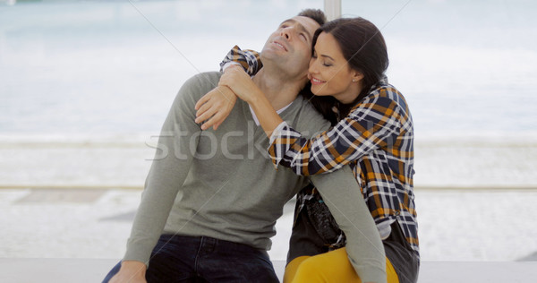Stock photo: Loving young woman hugging her boyfriend