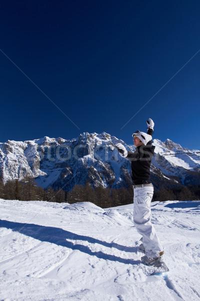 Femminile snowboarder felice rilassante italiana montagna Foto d'archivio © dash