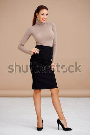 Sexy brunette woman standing isolated Stock photo © dash