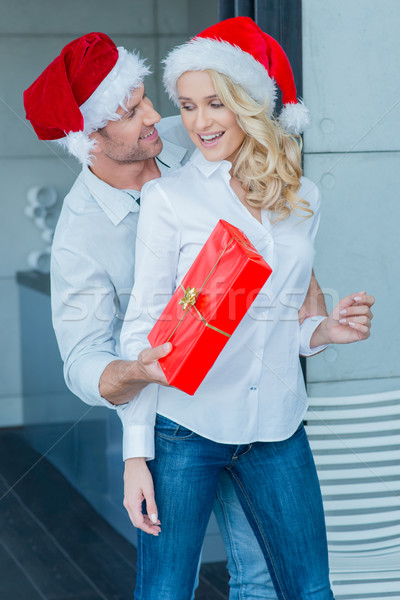 Husband surprising his wife with a Christmas gift Stock photo © dash
