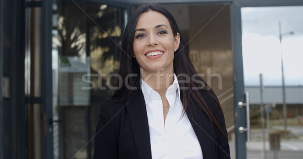 Young businesswoman exiting a modern office Stock photo © dash