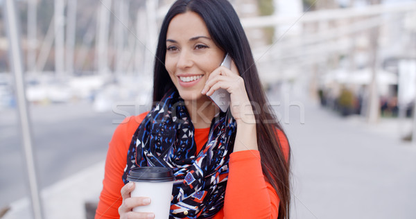 Fashionable young woman listening to a call Stock photo © dash