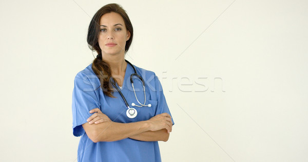 Woman in scrubs crosses arms and smiles at camera Stock photo © dash