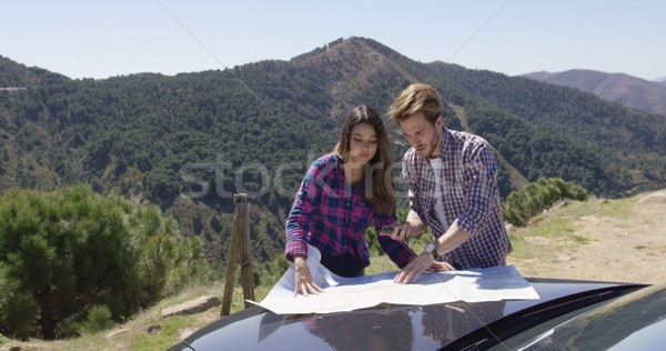 Two people looking at map searching route Stock photo © dash