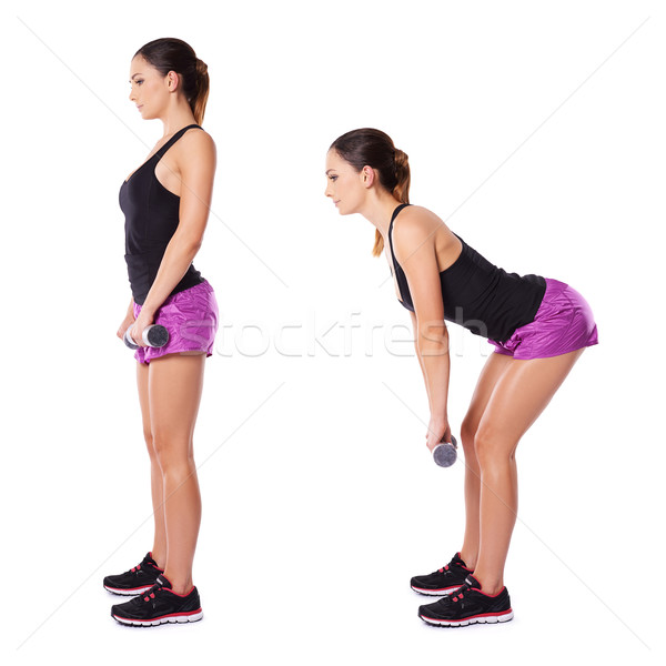 Stock photo: Woman working out with barbells