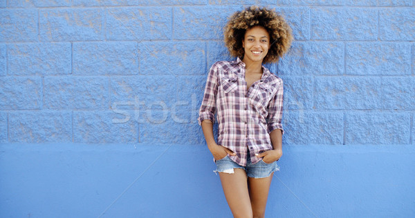 Female Posing Next To A Blue Wall Stock photo © dash