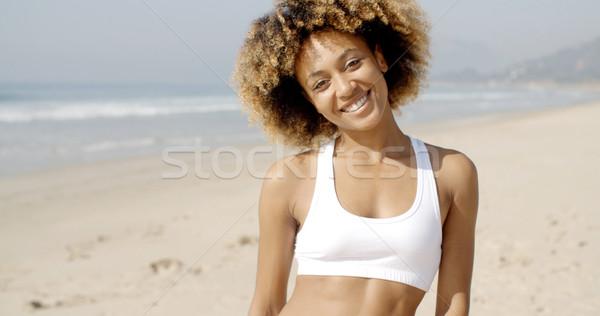 Portrait Of Girl Smiling On Beach Stock photo © dash