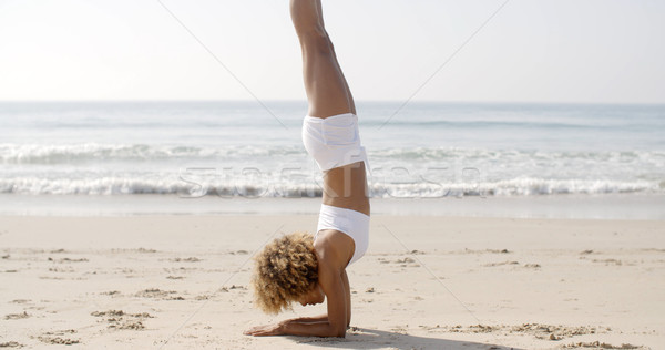 Woman Practicing Yoga On The Beach Stock photo © dash