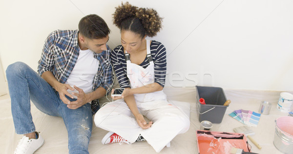 Young black couple sit and listen to music Stock photo © dash