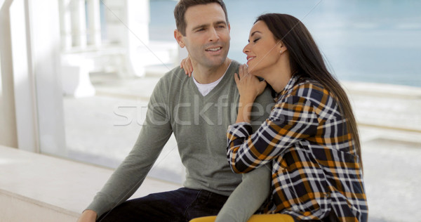 Romantic young couple sitting watching Stock photo © dash