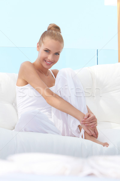 Pretty casual woman barefoot on sofa Stock photo © dash