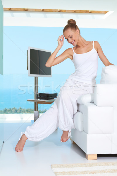 Graceful woman in white outfit Stock photo © dash