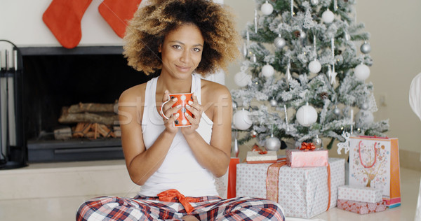 Blissful young woman drinking coffee at Christmas Stock photo © dash