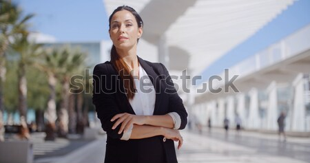 Pretty woman sitting beside a pedestrian walkway Stock photo © dash