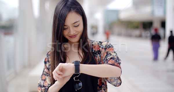 Young woman looking at the time with a smile Stock photo © dash