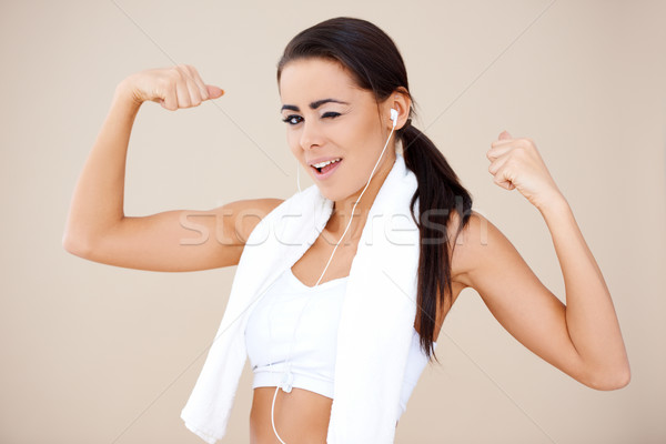 Attractive female showing her biceps Stock photo © dash