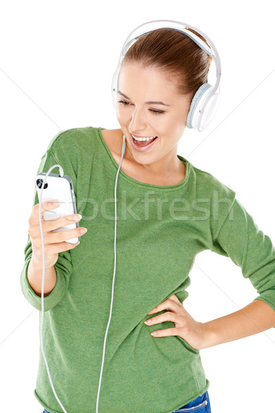 Woman laughing as she enjoys her music Stock photo © dash