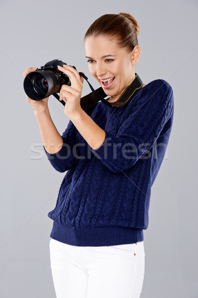 Female photographer assessing her shot Stock photo © dash