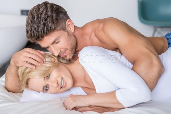 Romantic Partners Lying on Bed Fashion Shoot Stock photo © dash