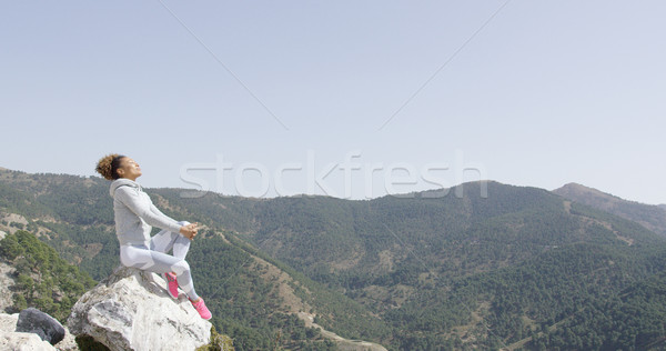 Happy sportive woman on rock Stock photo © dash