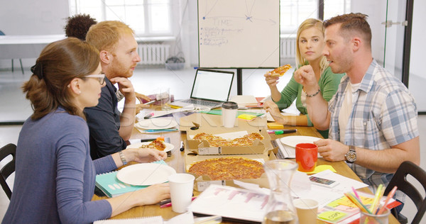 Young people enjoying pizza in office Stock photo © dash