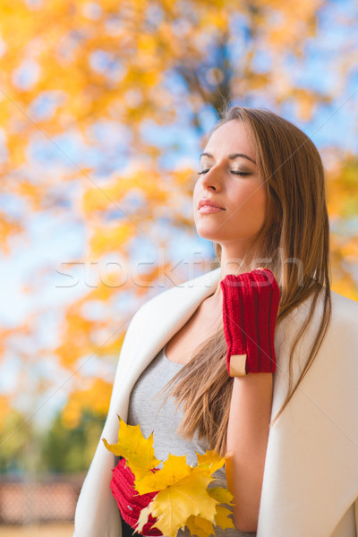 Young woman savoring the beauty of autumn Stock photo © dash