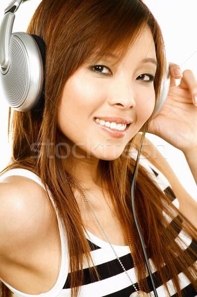 Słuchanie muzyki młodych asian piękna kobiet muzyki Zdjęcia stock © dash