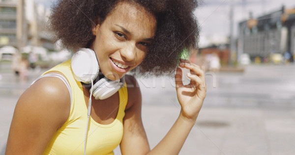 Model in headphones at street  Stock photo © dash
