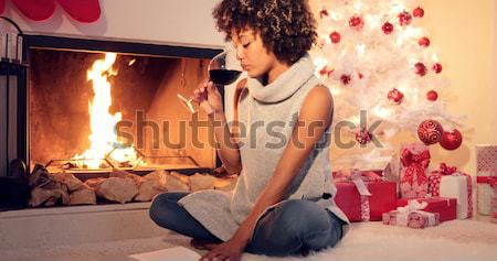 Chic young woman typing a Christmas message Stock photo © dash