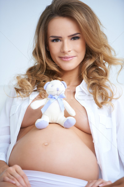 Pregnant mother with a gorgeous smile Stock photo © dash