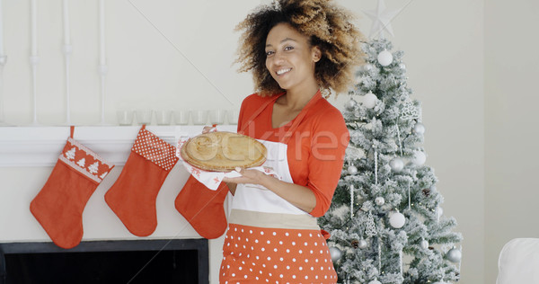 Happy trendy young woman with a Christmas dessert Stock photo © dash