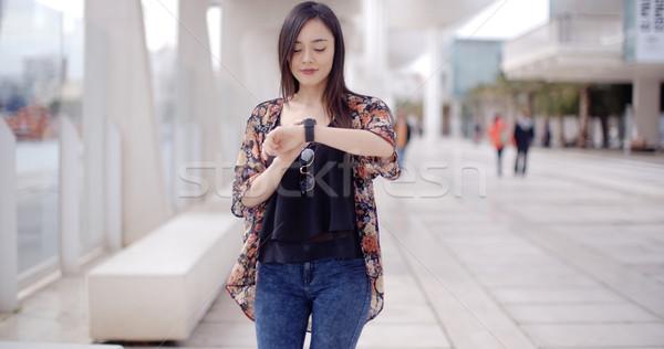 Young woman checking her wristwatch Stock photo © dash