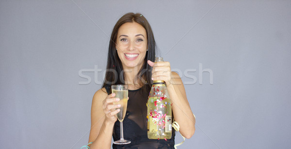 Charming woman welcoming in the New Year Stock photo © dash
